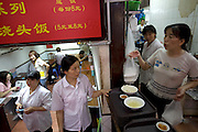 Waglong Restaurant in Pudong, Shanghai, China, where freelance computer graphics artist and internet gamer Xu Zhipeng occasionally orders his meals. Twice a day Xu Zhipeng tears himself away from an online game for less than a minute to order a meal. The food is delivered to his computer station 10 minutes later, where he eats it without interrupting his game. (Xu Zhipeng is featured in the book What I Eat: Around the World in 80 Diets).
