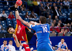 Eduardo Gurbindo of Spain vs Jakov Gojun of Croatia during handball match between Croatia and Spain for 3rd place game at 10th EHF European Handball Championship Serbia 2012, on January 29, 2012 in Beogradska Arena, Belgrade, Serbia.  (Photo By Vid Ponikvar / Sportida.com)