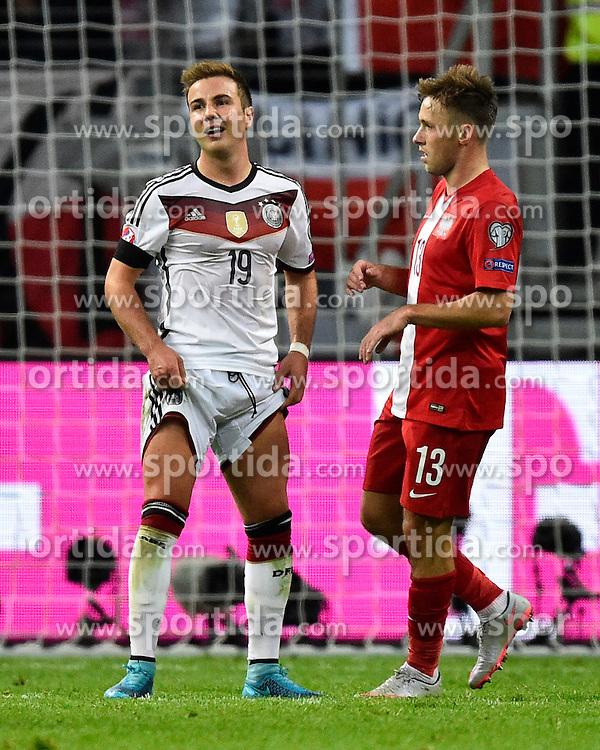 04.09.2015, Commerzbank Arena, Frankfurt, GER, UEFA Euro Qualifikation, Deutschland vs Polen, Gruppe D, im Bild Mario Goetze (GER) (links) mit Maciej Rybus (POL) // during the UEFA EURO 2016 qualifier Group D match between Germany and Poland at the Commerzbank Arena in Frankfurt, Germany on 2015/09/04. EXPA Pictures &copy; 2015, PhotoCredit: EXPA/ Eibner-Pressefoto/ Weber<br /> <br /> *****ATTENTION - OUT of GER*****