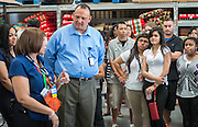 Walmart regional manager Todd Manley talks with his team and Scarborough High School students, May 22, 2014.
