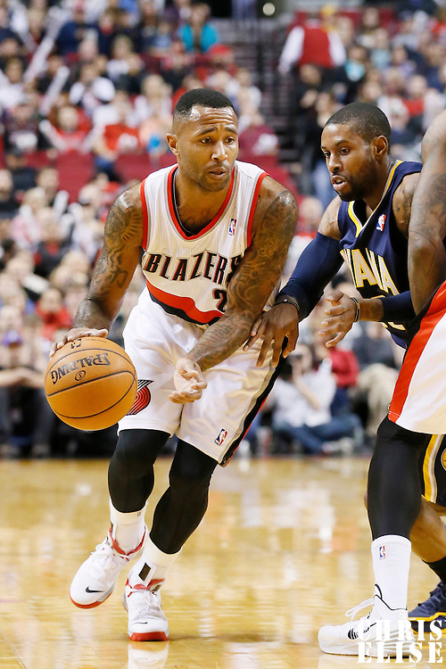 02 December 2013: Portland Trail Blazers point guard Mo Williams (25) drives past Indiana Pacers point guard C.J. Watson (32) during the Portland Trail Blazers 106-102 victory over the Indiana Pacers at the Moda Center, Portland, Oregon, USA.
