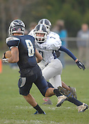 John Glenn's Derek Clyde (7) moves Petoskey's Joe Robbins (8) to the outside during the Bobcat's district playoff loss to the Petoskey Northmen.