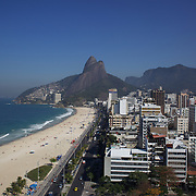 A general view of Leblon and Leblon beach showing the Dois Irmaos mountain peaks in the background, Rio de Janeiro,  Brazil. 30th July 2010. Photo Tim Clayton..