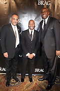 l to r : John Thompson, Gary Lambert, President of B.R.A.G and Magic Johnson at The B.R.A.G 39th Annual Scholarship and Awards Dinner Gala held at Cipriani Wall Sreet on October 23, 2009 in New York City...BRAG mission is to be the leading provider of resources and development suppoert that empowers African Americans to reach their highiest professional potential in retail and related industries