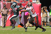Philadelphia Eagles running back LeSean McCoy (25) runs upfield as he tries to avoid  Tampa Bay Buccaneers linebacker Dekoda Watson (56) during the Eagles 31-20 win over the Tampa Bay Buccaneers on Oct. 13, 2013 in Tampa, Florida. <br /> <br /> ©2013 Scott A. Miller