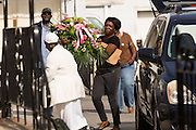 Mourners carry flowers into Fieldings Funeral home where the viewing for Walter Scott was held April 10, 2015 in Charleston, South Carolina. Scott was shot multiple times in the back and died on the scene after running from police in North Charleston.