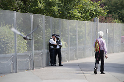 © Licensed to London News Pictures. 12/07/2018. London, UK. Police stand guard at a closed off section of Regent's Park surrounding the US Ambassador's residence where US President Trump will stay later.  Photo credit: Peter Macdiarmid/LNP