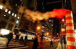 People walk past a smoke funnel in Wall Street in New York, New York, USA, 23 October 2008. As Wall Street descend into a financial turmoil not seen since the stock market crash of 1929 and financial businesses were pommeled into rampant sell-offs in stocks and face regulatory changes to their business practices, professionals and non-professionals working in the district's banks, stock-trading houses and insurance companies are showing stress and a gloom not unlike the times of the Great Depression.