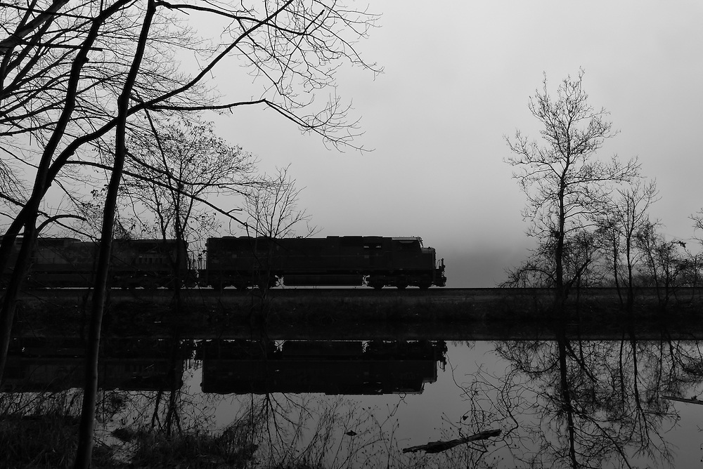 A southbound CSX train crosses one of many causeways along the Hudson River Line.