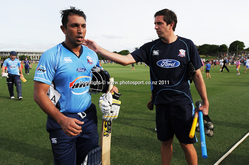 Azhar Mahmood leaves the field 79 not out at the HRV Twenty20 Cricket match between the Auckland Aces and Otago Volts at Colin Maiden Oval in Auckland, New Zealand on Friday 6 January 2012. Photo: Andrew Cornaga/Photosport.co.nz