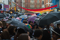 Portland Place, London, June 25th 2016. Thousands of LGBT people and their supporters gather for Pride in London, a colourful celebration of the hard-won rights of lesbian, gay, bisexual and transgender  people. PICTURED: A canopy of umbrellas appears to cover the thousands of revellers in Soho.