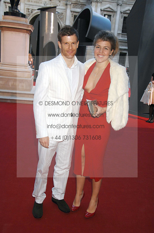 TOM AIKENS and his wife AMBER at the Royal Academy of Art Summer Exhibition Preview Party on 4th June 2008.<br />