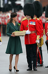 Catherine, Duchess of Cambridge presents  sprigs  of shamrock  to members of  the 1st Battalion Irish Guards  during a St Patricks Day Parade at Mons Barracks, Aldershot, Saturday 17th March 2012. .Photo by: Stephen Lock / i-Images