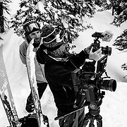 Sam Pope reviews footage with his assistant while in the Teton backcountry of Wyoming.