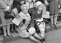 95145<br /> <br /> American President John Fitzgerald Kennedy (J.F.K.)'s visit to Ireland June 1963.<br /> Two ladies seated at Dublin Airport with American flags to welcome JFK on his historic visit.<br /> (Part of the Independent Newspapers Ireland/NLI collection.)