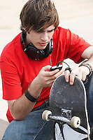 Young Skateboarder with MP3 Player