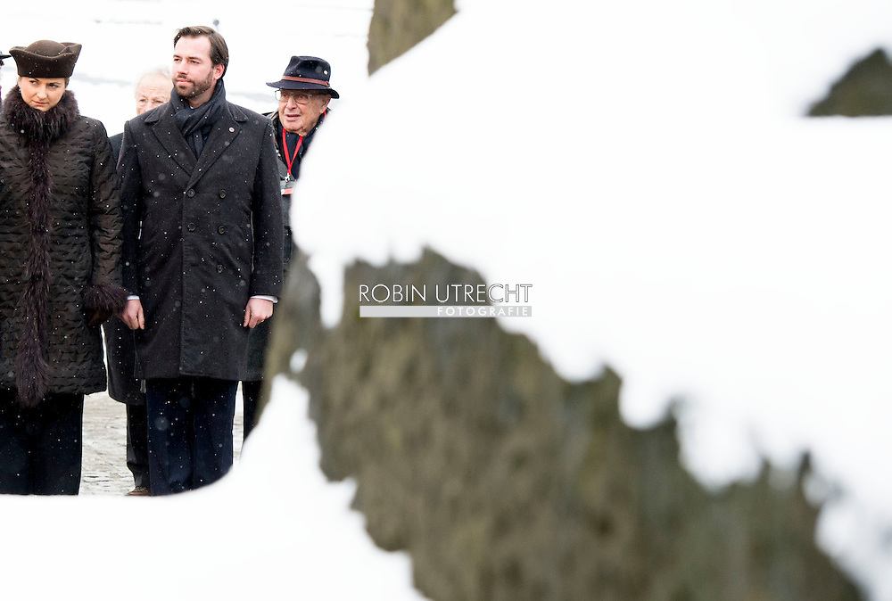27-1- 2015 AUSCHWITZ -  guillaume en stephanie van luxemburg  are laying a candle at the monument in Camp Birkenau  during the the 70 years commemoration in Camp Auschwitz II Birkenau  in poland . COPYRIGHT ROBIN UTRECHT