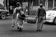Unable to wait for the Gas company to deliver the cooking gas cylinder at her home, a lady carries her own requirement to home.