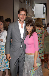 KRIS THYKIER and CLAUDIA WINKLEMAN at a party to celebrate the publication of iPod, Therefore I am by Dylan Jones held at Asprey, 169 New Bond Street, London W1 on 14th July 2005.<br />