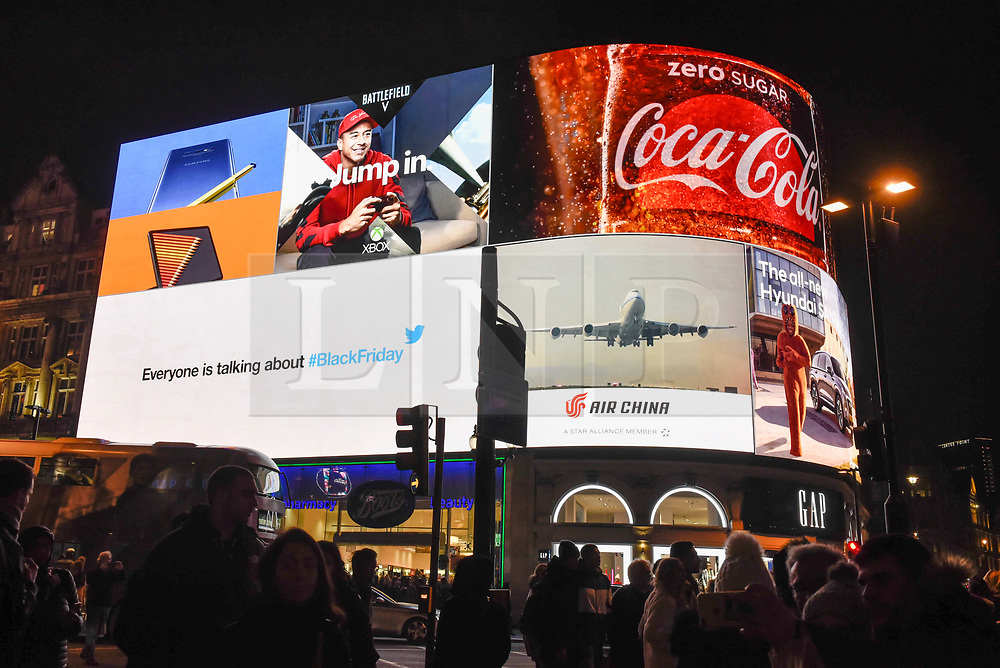© Licensed to London News Pictures. 23/11/2018. LONDON, UK. The giant advertising screen in Piccadilly Circus includes a message from social media company Twitter promoting its service on Black Friday.   Traditional retailers face increasing challenges to attract customers against their online competition.  Photo credit: Stephen Chung/LNP