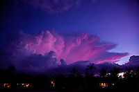 Large storm cloud looms over Hoi An in Vietnam at sunset.