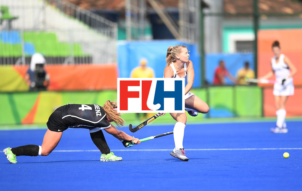Germany's Nike Lorenz (L) hits pat New Zealand's Kirsten Pearce during the women's field hockey New Zealand vs Germany match of the Rio 2016 Olympics Games at the Olympic Hockey Centre in Rio de Janeiro on August, 8 2016. / AFP / MANAN VATSYAYANA        (Photo credit should read MANAN VATSYAYANA/AFP/Getty Images)