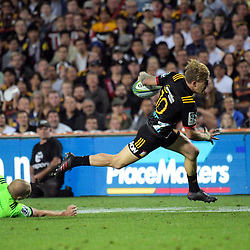 Damien McKenzie beats Matt Faddes during the Super Rugby match between the Chiefs and Highlanders at FMG Stadium in Hamilton, New Zealand on Friday, 30 March 2018. Photo: Dave Lintott / lintottphoto.co.nz