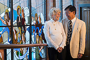 CENTENNIAL, CO - MARCH 18: Paul and Colleen Lum Lung pose for a portrait at St. Thomas More Catholic Parish on March 18, 2016, in Centennial, Colorado. (Photo by Daniel Petty/for the Catholic Foundation Alliance)
