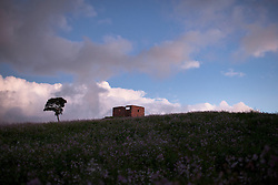 Dec. 30, 2011 - Guatavita, Colombia. The shell of a house on a hill. © Nicolas Axelrod / Ruom