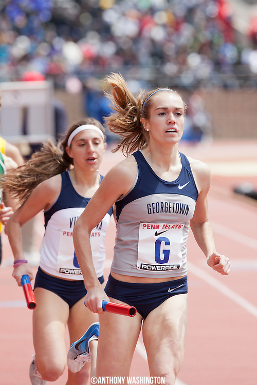 Rachel Schneider of the Georgetown University runs the second leg during the College Women's 4x1500 Championship of America during the Penn Relays athletic meets on Friday, April 27, 2012 in Philadelphia, PA.