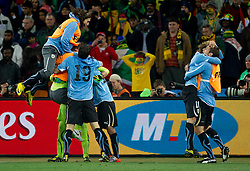 Players of Uruguay celebrate after penalty shots at the 2010 FIFA World Cup South Africa Quarter Finals football match between Uruguay and Ghana on July 02, 2010 at Soccer City Stadium in Sowetto, suburb of Johannesburg. (Photo by Vid Ponikvar / Sportida)