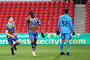 12 Fejeri Okenabirhie scores the equaliser for Shrewsbury Town during the The FA Cup 3rd round replay match between Stoke City and Shrewsbury Town at the Bet365 Stadium, Stoke-on-Trent, England on 15 January 2019.