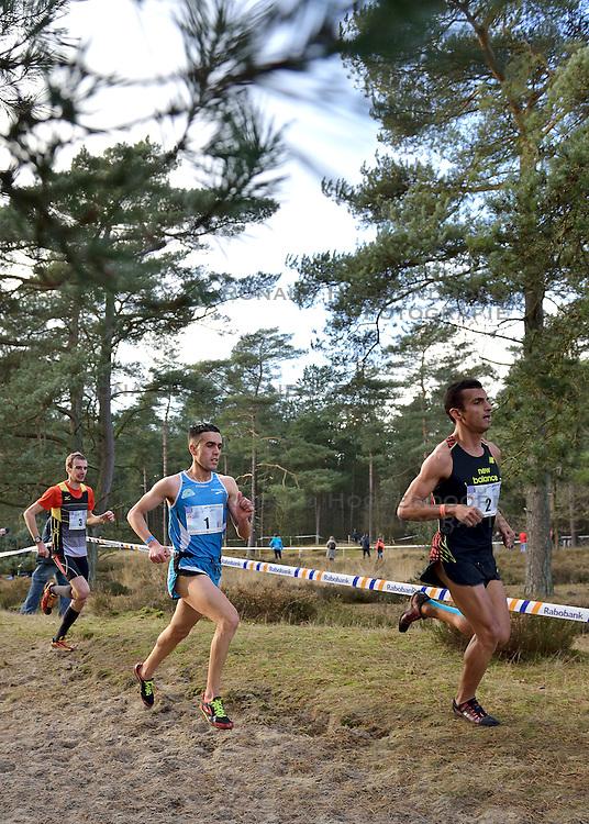 31-12-2014 NED: Rabobank Sylvestercross, Soest<br /> Khalid Choukoud is voor de tweede keer winnaar geworden van de Sylvestercross in Soest. Roman Romarenko (L), de kampioen van Oekra&iuml;ne, finishte op dertien seconden als tweede en de Belg Soufiane Bouchiki (R) eindigde op twintig seconden als derde.