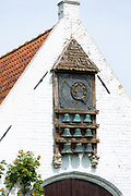 Traditional bells and clock tower at Damme, province of West Flanders in Belgium
