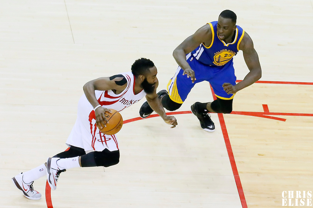25 May 2015: Houston Rockets guard James Harden (13) drives past Golden State Warriors forward Draymond Green (23) during the Houston Rockets 128-115 victory over the Golden State Warriors, in game 4 of the Western Conference finals, at the Toyota Center, Houston, Texas, USA.
