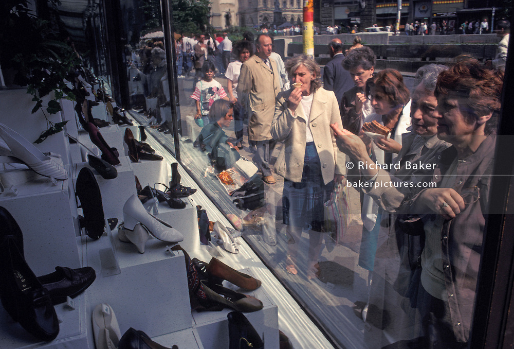 Hungarian woman shoppers admire the new range of shoes on display in a footwear shop on Vaci utca in central Budapest, on 18th June 1990, in Budapest, Hungary.