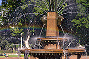 A rainbow passes through the Archibald Fountain, Hyde Park, Sydney. It is named afer J.F. Archibald, owner and editor of The Bulletin magazine, who arranged to have it built by French artist Francois-Léon Sicard. It was unveiled in Sydney in 1932.