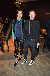 Left to right, GOGA ASHKENAZI and EVA CAVALLI at the PAD London 2015 VIP evening held in the PAD Pavilion, Berkeley Square, London on 12th October 2015.