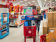 "28 NOVEMBER 2019 - ANKENY, IOWA: A shopper pushes a full cart in the Target store in Ankeny, Iowa. ""Black Friday"" is the unofficial start of the Christmas holiday shopping season and has traditionally thought to be one of the busiest shopping days of the year. Brick and mortar retailers, like Target, are facing increased pressure from online retailers this year. Many retailers have started opening on Thanksgiving Day. Target stores across the country opened at 5PM on Thanksgiving to attract shoppers with early ""Black Friday"" specials.    PHOTO BY JACK KURTZ"