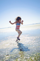 Little girl playing in water at the beach&#xA;<br />