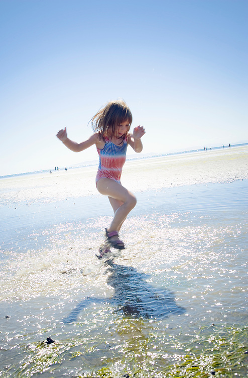 Little girl playing in water at the beach&amp;#xA;<br />
