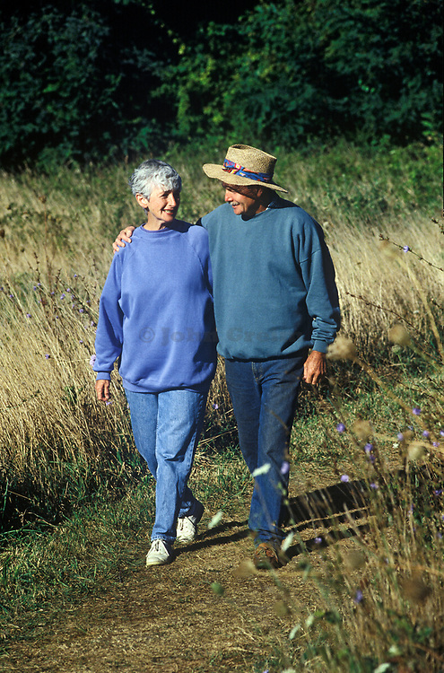 Senior couple walking  on path, Cape Cod, MA