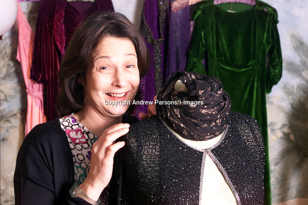 Feature on Kyra Segal who owns shop  'Gallery' of antique costume and textiles, Church St, London, 2000. Photo by Andrew Parsons/i-Images.