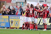 Tom Barkhuizen celebrates in front of his fans after restoring the 2 goal cushion during the Sky Bet League 2 match between AFC Wimbledon and Morecambe at the Cherry Red Records Stadium, Kingston, England on 17 October 2015. Photo by Stuart Butcher.