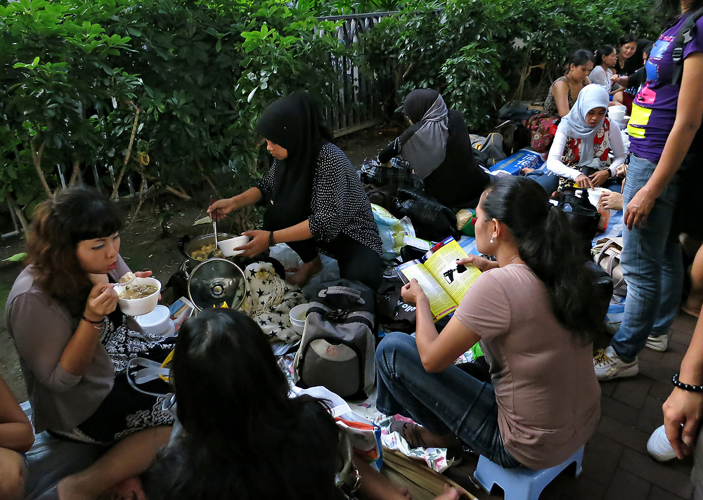 Domestic workers make lunch on their day off in Causeway Bay, Hong Kong, China; September, 2013.