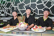 Chefs at Wild Ginger III hold sushi platters as they pose for a photo Friday August 28, 2015 in New Hope, Pennsylvania.  (Photo by William Thomas Cain)