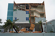 The end wall of the Fairfield Inn is partially missing after Hurricane Harvey struck Rockport, Texas August 26, 2017. REUTERS/Rick Wilking