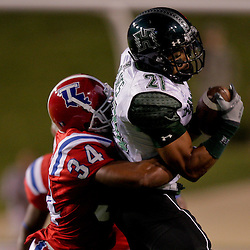 Sep 30, 2009; Ruston, LA, USA; Hawaii Warriors wide receiver Kealoha Pilares (21) is tackled by Louisiana Tech Bulldogs safety Antonio Baker (34) after a first half reception at Joe Aillet Stadium. Louisiana Tech defeated Hawaii 27-6. Mandatory Credit: Derick E. Hingle-US PRESSWIRE
