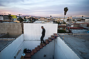 Photo artist Aldo Guerra on the roof of his apartment in Tijuana, Mexico.