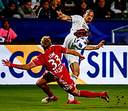 Los Angeles Galaxy's forward Zlatan Ibrahimovic (9) of Sweden, vies with New York Red Bulls' defender Aaron Long (33) during the 2018 Major League Soccer (MLS) match in Carson, California, April 28, 2018. New York Red Bulls won 3-2.